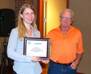 Crystal Brezina accepts the DSAS from Education Committee Manager Dan Voss, who was Crystal's mentor last year. (Photo by W.C. Wiese)