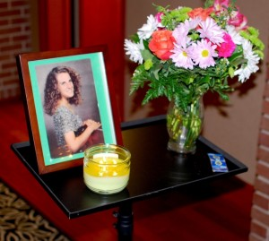 The traditional candle-lit memorial display honors Melissa Pellegrin each year during the scholarship presentations.
