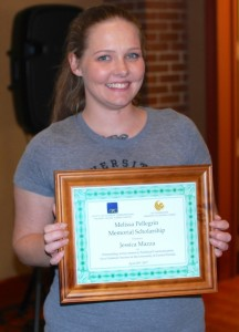 Recipient Jessica Mazza proudly displays her plaque.  (Photo by W.C. Wiese)